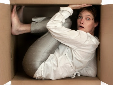 Woman cramped in box
