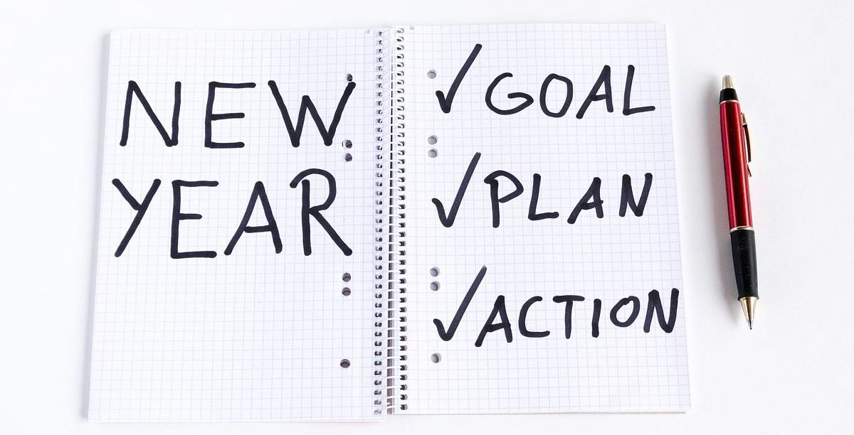Notebook with New Year, Goal, Plan, Action written in it