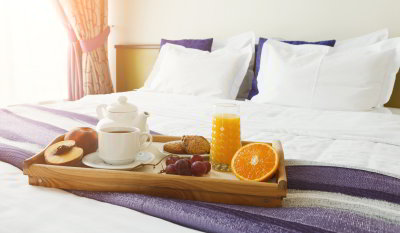 Tray of breakfast on a bed