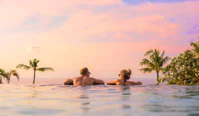Couple looking at the view from an infinity pool