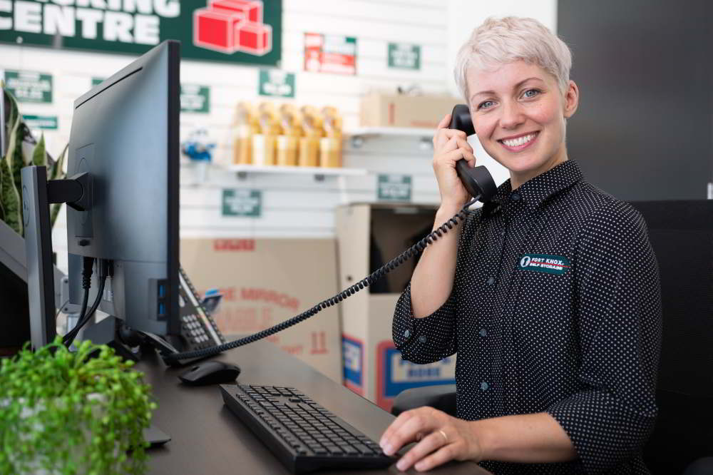 Fort Knox Storage expert on phone with customer