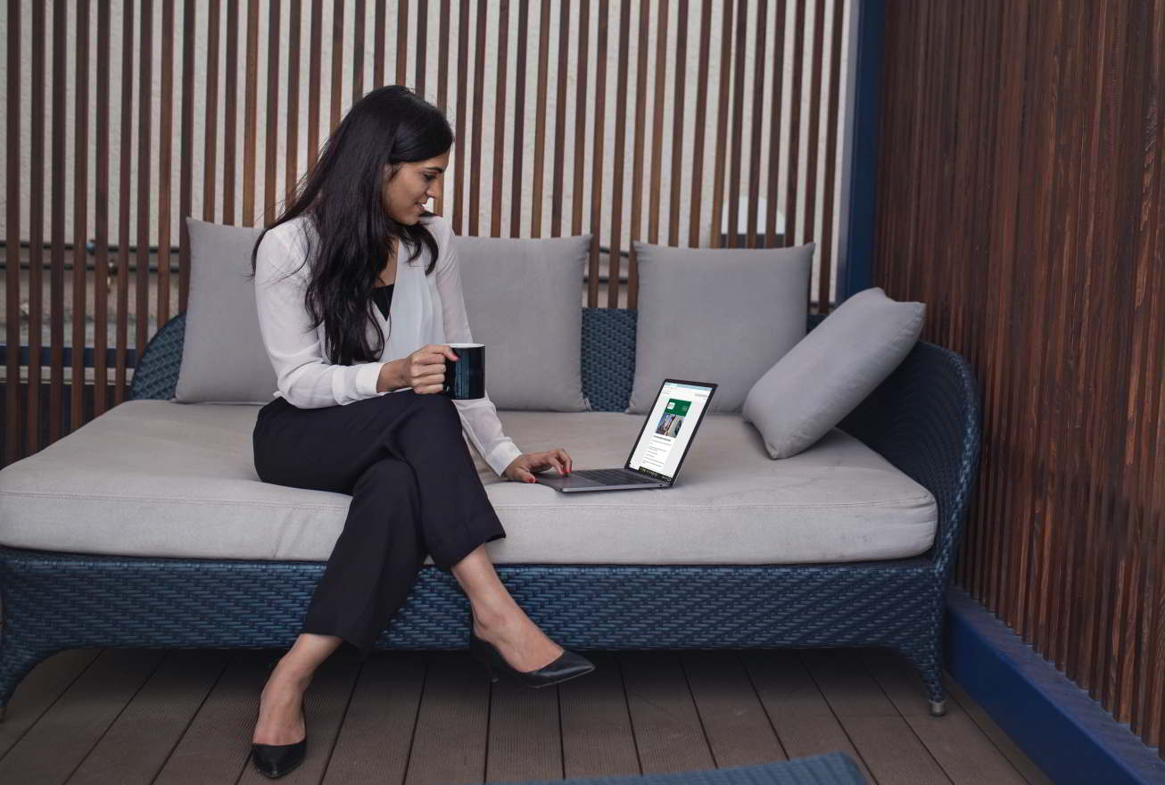 Woman signing up for a storage unit onlinefrom her patio